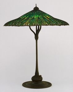 Louis Comfory Tiffany (1848-1933) - Lotus Leaf Table Lamp. Leaded Glass & Bronze.