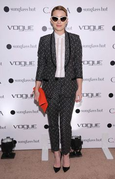 Emma Roberts attends the Vogue Eyewear and CFDA unveiling of the 'Emma' sunglass in NYC in Nanette Lepore.