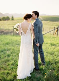 Love the back of this dress!  So pretty.  Romantic White Wedding in Napa