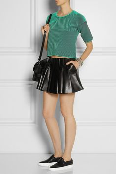 Alexandra Wang | Ribbed jersey top | Alexander Wang|Pleated leather mini skirt|Common Projects | Leather sneakers | Proenza Schouler | The PS11 Classic leather shoulder bag | Bottega Veneta | Sterling silver bracelet | Maria Black | Double Harper oxidized silver two-finger ring