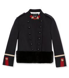 Gucci - Black wool jacket with red and gold bee brooches and a fur trimmed hem.