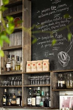 rustic weathered grey barnwoods, chalkboard and greenery. Display section.