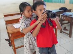 Our adorable students at Volunteer Programs Bali helping each other by learning how to take a picture. #teamwork