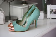 Aqua pumps with a rose gold cap toe. Perfect! Made by Nelly.