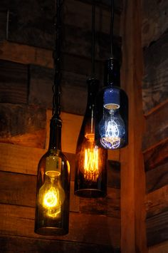 Wine Bottle Pendant Lamp with Edison Lightbulb by heirloom2011, $52.00.  I bet I can do this!