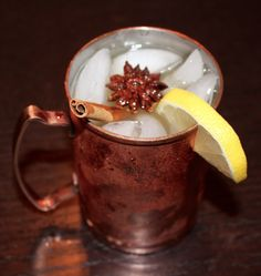 """Cider Mule""  - 2 oz. of unfiltered apple cider - 2 oz. of ginger beer - 1 1/4 oz. of ginger vodka  - dash of Allspice  Garnish with a cinnamon stick & a lemon wedge"