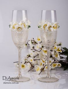 decorate champagne glasses. Toasting flutes  ivory spring theme wedding champagne glasses hand decorated on Etsy 47 00 Martha Stewart glitter Cure in oven and it will be