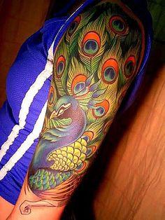 trendy peacock tattoo on the half sleeve