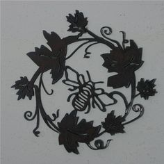 Grape vine w/ Bee   - Metal art. $20.00, via Etsy. For my House