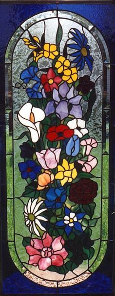 stained glass bathroom window in flower design  Some of the flowers in this bathroom window next to the master bedroom match the flowers in the bedroom decorating scheme. Since this bathroom window is directly across from the neighbor's window, it also provides privacy while letting in the light. This home is in Naperville, IL.