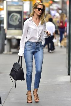 Rosie Huntington-Whiteley in Paige Denim skinny jeans and silk blouse with brown lace up Aquazzura sandals.