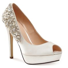 Indulgence is a stunning peep toe platform wedding or specialoccasion shoe featuring gorgeous embroidery across the heel which will surely...