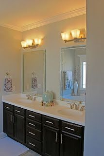 Could paint/stain existing cabinets, add hardware, replace counter/sinks, mirrors and lights.