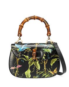 """Gucci tropical-print textured leather satchel bag with golden hardware. On mould construction. Hand-painted edges. Bamboo handle, 6"""" drop. Adjustable shoulder strap, 19"""" drop. Flat top; bamboo turn-lo"""