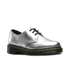 This is our classic 3 eye shoe. The second style that Dr. Martens made, the shoe was crafted for industry — and made rebellious by generations of non-conformists. The 1461 is crafted with the same Doc's DNA as its 8-eye counterpart, like grooved edges and yellow stitching. It's built on our iconic, comfortable air-cushioned sole, that's oil and fat resistant, with good abrasion and slip resistance. Best of all, the sole is secured using one of the finest construction methods avail...