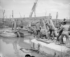WWI, 27 June 1917; Troops of the Royal Engineers repairing a lock on a canal at Blangy damaged during the Battle of Arras. ©IWM Q 5527