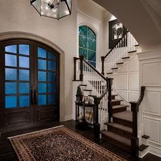 Great Front Doors & the contrast of dark wood and lighter walls with the white wood work.