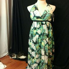 """Floral  Print  Maxi Dress Preloved  but  still  in  good  condition .   Ties in back at the  neck. Elastic  at mid back .  Black  elastic  waistband in back  . Polyester. Machine  wash  inside  out .  V-neck .  Length  58"""". Waist  32"""". Bust  36"""". New York & Company Dresses Maxi"""