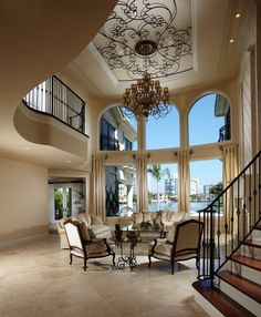 Pretty sauder harbor view in Living Room Mediterranean with Two Story Family Room next to High Ceiling Lighting alongside Dining Room Curtains and Ceiling Medallion