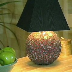 HGTV.com shows you how to embellish a lamp with a mosaic overlay using tempered glass.