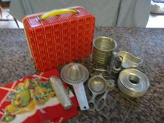 Cool vintage Ohio Art lunch box with lots of cool vintage kitchen gadgets. Lunch box is in good condition; has old K-mart 1.09 paper label inside. Gadgets include: patented juistractor; Foley reamer; pie crimper; spice grater; 11 little aluminum molds; Swiss Salu German tea strainer; cheese slicer; 1.5 measuring cup; and a kitchen towel. $68 on GoAntiques