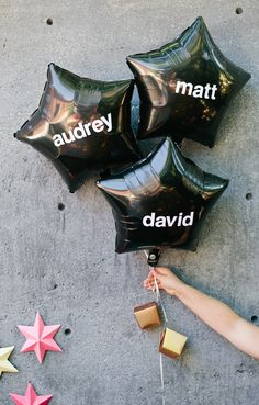 Balloons with adhesive stickers as fun place card holders.