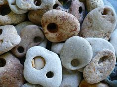 """kerryalaska: """" Hag stones, also known as Holey Stones or Witch Stones are stones that have a naturally occurring hole and are usually found near oceans and other bodies of water. They are said to be powerful protection talismans, and when worn or. Hag Stones, Story Stones, Sea Witch, Beach Stones, Beach Rocks, Rocks And Gems, Book Of Shadows, Rocks And Minerals, Stone Art"""