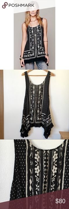 Free People Bandana Border Print Tunic  Very unique printed tunic with an asymmetrical hem in a size Medium. No flaws at all- In pristine condition  Rare and sought after! Please feel free to ask any/all questions! Free People Tops Tunics