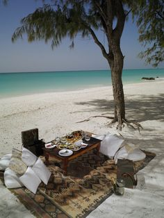 Any idea where in the world this barefoot luxury beach picnic is? Click for a clue!