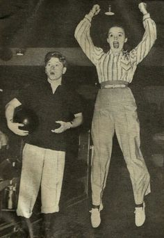Judy Garland bowling with Mickey Rooney. (1940) by Selkie~gal