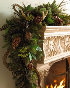 Horchow garland with feathers and antlers: Perfect decor for Thanksgiving and into Christmas - warms up the room during the winter season.