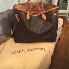 Authentic Louis Vuitton NeverFull GM Bag! Trades! Neverfull Monogram Bag gently used and I only want to trade for another Authentic LV. I would only trade from a reputable trader too so no scammers thanks! I purchased this bag from Louis Vuitton at Bloomingdales 59th & Lex. Comes with the original dust bag too. Louis Vuitton Bags