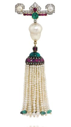AN ART DECO PEARL, RUBY, EMERALD AND DIAMOND TASSEL BROOCH, BY CARTIER  The old-cut diamond-set bar surmount with single button-shaped pearl terminals, central emerald and ruby highlights, suspending an inverted baroque shaped pearl spacer and pearl tassel drop, with emerald bead finials, ruby and rose-cut diamond-set cap, 1920s, 11.8 cm, with French assay marks for platinum and gold Signed Cartier Paris, no. 5802.