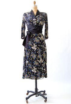 Navy blue print rayon blouse and skirt set, c. 1930s. Blouse has an obi-inspired sash and fabric-covered buttons.