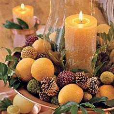 Great #centerpiece for your #thanksgiving #table #candles #pinecones #leaves #traditional #statement #autumn #decor #homedecor