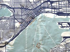 Emily Fischer, seamstress extraordinaire, knots and embroiders city hot spots of your choosing (the hospital, her first address, the local park) onto a cotton quilt that's been digitally printed with a graphic representation of the place you call home.