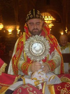 Archbishop Boutros Mor Selwanos displaying the Ancient and Holy Girdle of the ever blissful and blessed Mother of God. The Syriac Orthodox Church has the rare privilege to have with her the Girdle of St. Mary. The Girdle of Virgin Mary was handed over to Apostle St. Thomas, during her assumption to heaven. As the Church celebrates the Feast of the Assumption on Aug 15th, we seek the most powerful intercession of the Holy Theotokos.