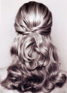 Twisted half up curly updo