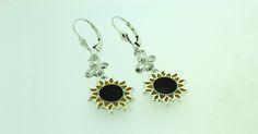 .925 sterling silver or 14kt gold plated .925 sterling silver sunflower earrings with butterfly featuring real Swarovski crystals.