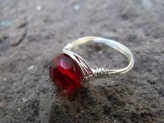 Red glass crystal wrapped in silver