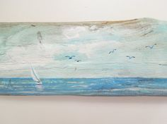 A sailboat, seagulls and water are depicted on this wonderful piece of driftwood. This piece of Lake Erie driftwood was found at a local beach and then painted by me with this peaceful view of the water. Five seagulls float by as they soar the cloud-filled skies. This quaint little painting would add a coastal touch to any nook. The driftwood measures 3 1/8 x 11. The painting has a layer of satin varnish for added protection. The back is equipped with a saw tooth hanger for easy hanging....