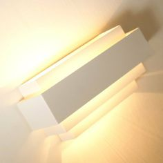simple, lovely,comtemporary up and down wall ight,easy to be fixed to wall http://www.amazon.co.uk/dp/B00I2KLNVK/ref=cm_sw_r_pi_dp_W76qtb1JGHZ7X