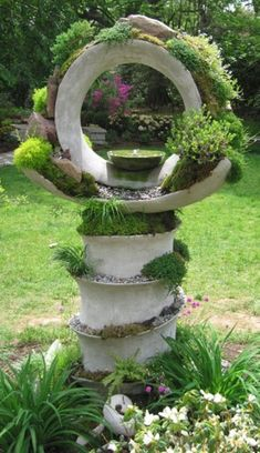 I want to try flower pot hangers with interweaving circles (I've seen them in… sculpture concrete yard art Wallace Gardens Unique Gardens, Amazing Gardens, Garden Crafts, Garden Projects, Garden Ideas, Garden Ornaments, Outdoor Projects, Dream Garden, Yard Art