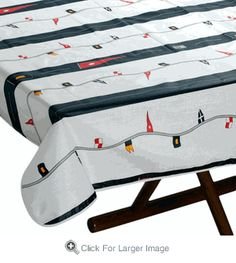 Bring nautical style to your table with this signal flag and stripe print table cloth!