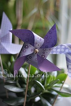 Paper pinwheels for fun and plant pokes - cut them from contac paper covered scrapbook beauties - waterproof, too!
