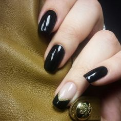 Black shellac mani with black french chevron tip accent nail and gold glitter
