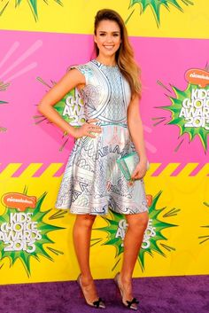Jessica Alba carries our Summer '13 faux python Grace clutch at the 2013 Kids Choice Awards.