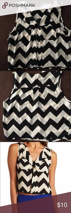 MUST HAVE❣Charlotte Russe Chevron Crop Top Charlotte Russe Chevron Chiffon Crop Blouse Size Medium. Black & Cream Model photo is from the Charlotte Russe site and shows how the cropped blouse typically looks.                              ❕TOP RATED SELLER❕                📦 FAST SHIPPING‼️📦                💕Quick Responses!💕                👌🏼Bundle to save 10%! Charlotte Russe Tops Crop Tops