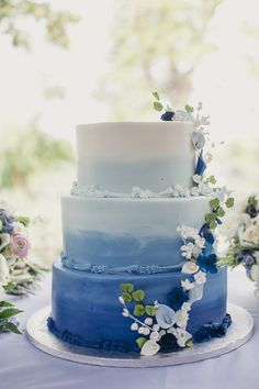Blue ombre wedding cake: Cake: Occasionally Cake - http://www.stylemepretty.com/portfolio/occasionally-cake Floral Design: Helen Olivia Flowers - http://www.stylemepretty.com/portfolio/helen-olivia-flowers Photography: Elisha Coleman, Love Life Images - www.lovelifeimages.com   Read More on SMP: http://www.stylemepretty.com/2017/05/12/vintage-inspired-river-farm-wedding/