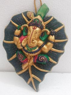 Beautiful #handpainted #ganesha on a leaf wall plate /table top shop online with #craftshopsindia